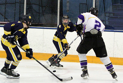 ANNA NORRIS/CHRONICLE Olmsted Falls' Bailey Carson passes to Colin Wilson against Avon's Shane Dockerty in the third period of the first semifinal game of the Southwest Conference tournament at North Olmsted Rec Sunday afternoon.