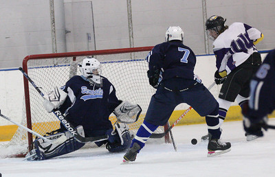 Avon's Alex Guzik scores against Cleveland Benedictine at North Olmsted Recreation Center. photo by Ray Riedel