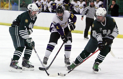 ANNA NORRIS/CHRONICLE Avon's Joe Goetz battles for control of the puck against Western Reserve Academy's Alec Rhodes, left, and Austin Rand.