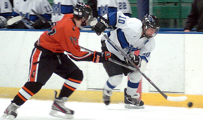 Midview's Jacob Lyons works the puck past Normandy's Alex Schirripa. LINDA MURPHY/CHRONICLE