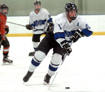 Midview's Kyle Kudela takes the puck down the ice. LINDA MURPHY/CHRONICLE