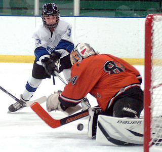 Midview's Tommy Coon takes a shot at Normandy's goal as goalie John Schmook pounces on it. LINDA MURPHY/CHRONICLE