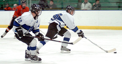 Midview's Jacob Hack and Jacob Lyons take the puck down the ice. LINDA MURPHY/CHRONICLE