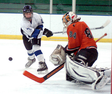 Midview's Tommy Coon takes a shot at Normandy's goal, guarded by John Schmook. LINDA MURPHY/CHRONICLE