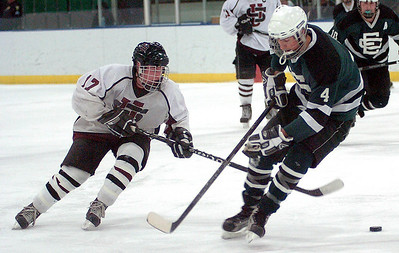 2-11-10 linda murphy  EC's #4 Paul Case tries to stop University's #17 Ian Robertso from taking the puck down the ice.