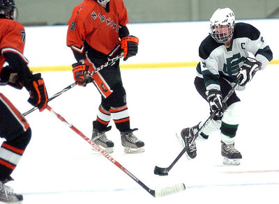 EC's #9 James Baker sets up to take a shot at goal past Normandy's #7 Evan Dunlay.