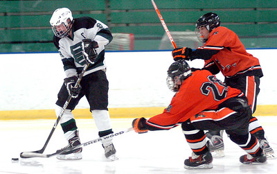 EC's #8 Seth Wechter works the puck away from Normandy's #28 John Vometz and #7 Evan Dunlay.