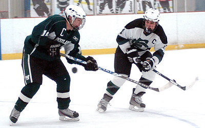 EC's #11 Collin Lester and Westlake's #16 Rudy Keppler fight for the puck.