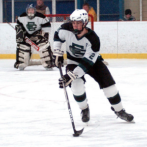 EC's #2 Jack Walter takes the puck down the ice. EC's goalie is #1 Luke Farmer.