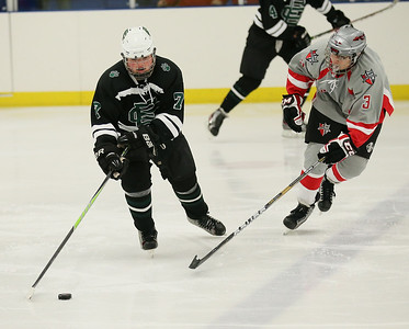 EC's Will Gentry looks to maneuver the puck past Parma's Allen Cartwright.  photo by Ray Riedel