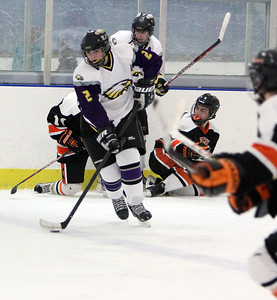 Avon's Shane Docherty recovers the puck against Normandy in the first period Sunday afternoon at Serpentini Arena in Lakewood. ANNA NORRIS/CHRONICLE