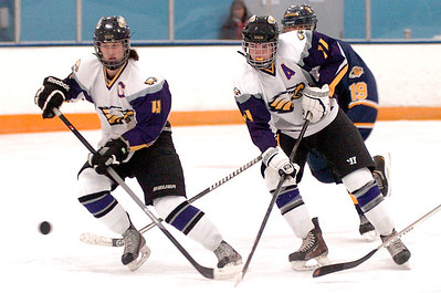 Avon's Eric Novakovic, left, and Braeden Friss take the puck down the ice in front of Olmsted Falls' Jacob Norman. LINDA MURPHY/CHRONICLE