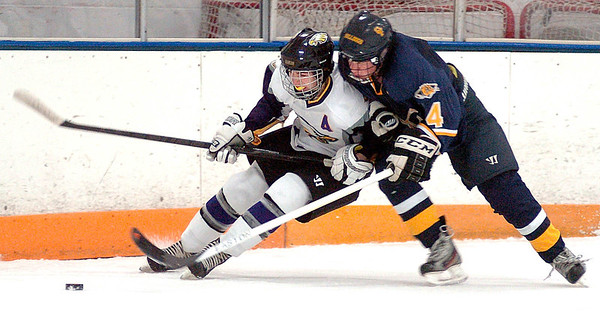 Avon's Braeden Friss keeps Olmsted Falls' Mark Schindler from the puck as he goes around the boards. LINDA MURPHY/CHRONICLE
