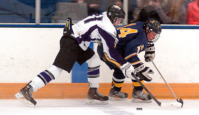 Avon's Braeden Friss keeps Olmsted Falls' Mark Schindler from the puck. LINDA MURPHY/CHRONICLE