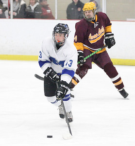 03Feb13___Manny Ceja of Midview takes the puck down the ice. In the background is Avon Lake forward Cody Bertrand at North Park Ice Rink in Elyria. photo by Ray Riedel