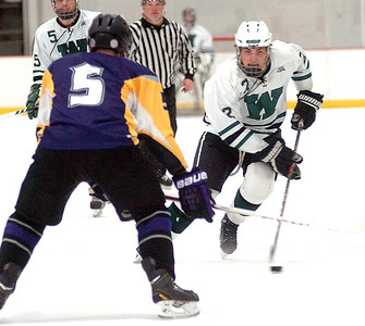 Westlake's Adam Sandor works the puck past Avon's Dominic Bowlin. LINDA MUPRHY/CHRONICLE