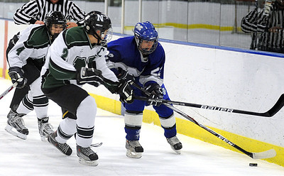 Midview Austin Steindl moves past Nordonia 2 Mike Gabriel and 4 Aaron Schnmitt Feb. 8.  Steve Manheim