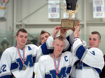 Midiview's players raise the Baron Cup.