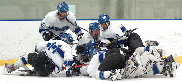Midview jumps into a celebration pile after winning.