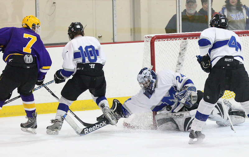 Midview goalie Jared Meredith (24) gets a save against Lakewood's Colin Scheel (7) as Jacob Lyons (10) and Bradley Urig (4) defend.  photo by Ray Riedel