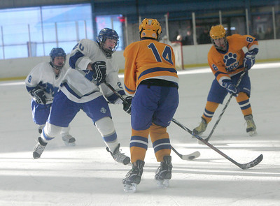 Midview's #20 Brock Behler tries a shot on goal past NDCL's #14 Mitchell Passalacqua; #9 for Midview is Brandon Benton; #8 NDCL is Sean Murphy. photo by Chuck Humel
