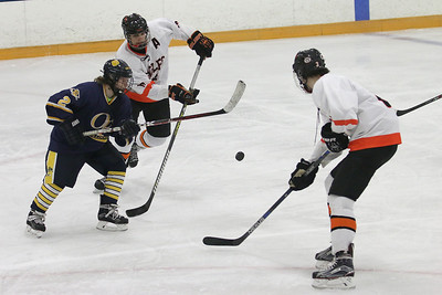 Olmsted Falls' Patrick Kerr (2) and North Olmsted's Tyler Merth (12) go for the puck in front of North Olmsted's Zach Servidio (3) during the semifinals for the Southwestern Conference on Sunday, Jan. 17, 2016, at the North Olmsted Recreation Center. BRIAN J. SMITH/CHRONICLE