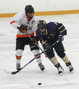 North Olmsted's Jake Hirz (8) trys to control the puck from Olmsted Falls' Dominic Conte (9) during the semi finals for the Southwestern Conference on Sunday, Jan. 17, 2016, at the North Olmsted Recreation Center. BRIAN J. SMITH/CHRONICLE