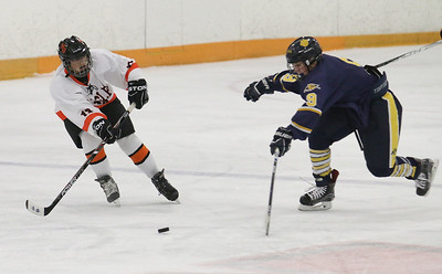 North Olmsted's Jon Novak (13) gains control of the puck from Olmsted Falls' Dominic Conte (9) during the semi finals for the Southwestern Conference on Sunday, Jan. 17, 2016, at the North Olmsted Recreation Center. BRIAN J. SMITH/CHRONICLE
