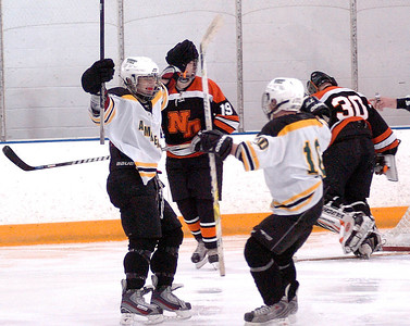 Amherst's #8 Michael Dzoba celebrates his second goal with teammate #10 Jordan Reynolds.
