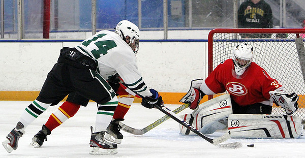 Westlake's Brendan Teets attempts a shot on goal against Brecksville goalie Eric Bolon. ANNA NORRIS/CHRONICLE