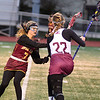 Avon Lake's Liv MacDonald tries to knock the ball from Rocky River's Bridget McCue April 16. STEVE MANHEIM / CHRONICLE