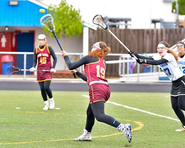 Isabel Calogeras makes a shot on goal Saturday in Avon Lake's 15-4 win over Bay. JESSE GRABOWSKI / CHRONICLE