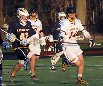 Avon Lake's Brandon Baiers (14) moves past Olmsted Falls' Garrett Dietrich (47) April 15. STEVE MANHEIM/CHRONICLE