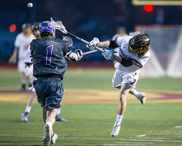 Avon Lake's Tanner Tracy, right, scores over Avon's Jacob Folds during Monday's game at Avon Lake. Tracy scored four goals to lead the Shoremen to a 10-4 win.  JOE COLON / CHRONICLE