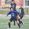 KRISTIN BAUER / CHRONICLE  <br /> Wellington High School's Cole McLean (BLUE-21) headers the ball as Amherst Steele High School's Kyle Mantin (GREY-2) attempts to regain control of the ball on Satuday afternoon, November 18 during the annual Lorain County All-Star Game.
