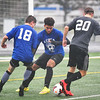 KRISTIN BAUER / CHRONICLE  <br /> Open Door's David McDonald (BLUE- 18), Columbia High School's Justin Krase (BLUE- 8) and Vermilion High School's CJ Koller (GREY- 20) battle for control of the ball on Saturday afternoon, November 18 during the annual Lorain County All-Star Game.