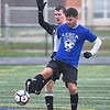 KRISTIN BAUER / CHRONICLE  <br /> Avon High School's Owen Lacko (BLUE-1) kicks the ball away from Amherst Steele High School's Kyle Mantin (GREY-2) on Saturday afternoon, November 18 during the annual Lorain County All-Star Game.