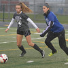 Grey Colleen Benton, Midview, left, and Blue Megan Sikora, Avon, play in the Lorain County All-Star soccer game Nov. 18.  STEVE MANHEIM / CHRONICLE