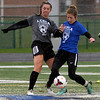 Grey Paige Kramer, Amherst, left, and Leah Songer of Blue team, FIrelands, play in the Lorain County All-Star Soccer game Nov. 18. STEVE MANHEIM / CHRONICLE