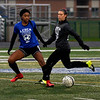 Blue team Ja'Maya Ward of ELyria and Grey team Kayla Jacobs of Brookside play in the Lorain County All Star Game Nov. 18.  STEVE MANHEIM / CHRONICLE