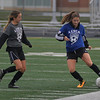 Blue team Emily Dahl of Avon, left, and Grey team Shelby Dowdell of Brookside play in the Lorain County All Star Soccer game Nov. 18. STEVE MANHEIM / CHRONICLE