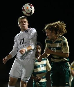 Highland's Joshua Woolard heads the ball away from Firestone's Joey Aronhalt during the first half. AARON JOSEFCZYK/GAZETTE