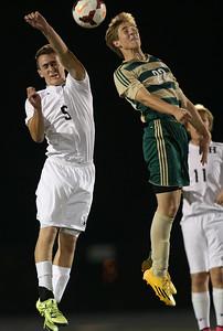 Highland's Adam Nagy heads the ball over Firestone's Jacob Weber during the first half. AARON JOSEFCZYK/GAZETTE
