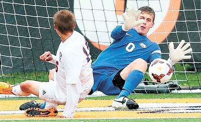 Medina's Zach Hlas makes a save on a shot by Berea-Midpark's Troy Scheel during the first half. (RON SCHWANE / GAZETTE)