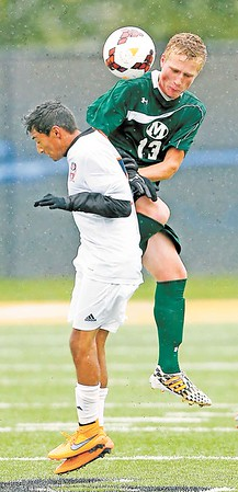 Medina's Brandon Leckie controls a header over Berea-Midpark's Sundeep Tudo during the first half. (RON SCHWANE / GAZETTE)