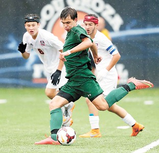 Medina's Nick Manhoff scores the first goal of the game against Berea-Midpark's Nicholas Ruggiero, left, and Klye Klimo during the first half. (RON SCHWANE / GAZETTE)
