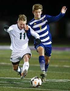 Medina's Andy Prostor (11) battles Copley's Michael Ruch for the ball during the second half. (RON SCHWANE / GAZETTE)