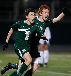 Medina's Cole Werthmuller (6) celebrates with Ian Gummo after scoing a goal against St. Ignatius during second half of the State semi-final. (RON SCHWANE / GAZETTE)