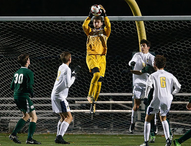 Medina's Tyler Glasenapp makes a save against St. Ignatius during second half of the State semi-final. (RON SCHWANE / GAZETTE)