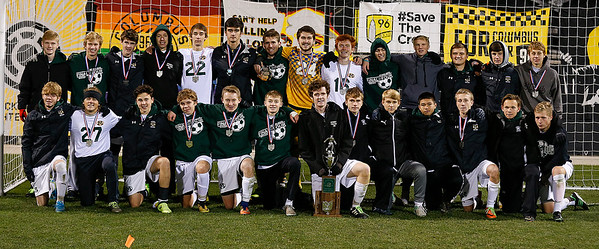 The Medina Bees boys soccer team poses with the State runner-up trophy after losing to Beavercreek 1-0 in the second overtime of the Division I State Championship game. (RON SCHWANE / GAZETTE)